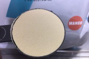 【WPC】Impactホエイプロテイン「マンゴー味」の粉末の様子